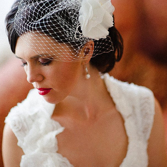 A birdcage veil is a lovely alternative to the traditional veil